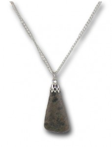 Uranium Ore (Carnotite) Pendant. Strength is 4 uSv/hour